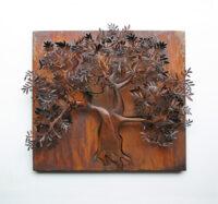 escultura en relieve de acero de el olivo
